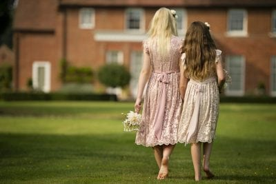 Blush and Dusky Pink flower girl, christening & party dresses. Lace overlay and ruffle sleeve Rosie dress design.