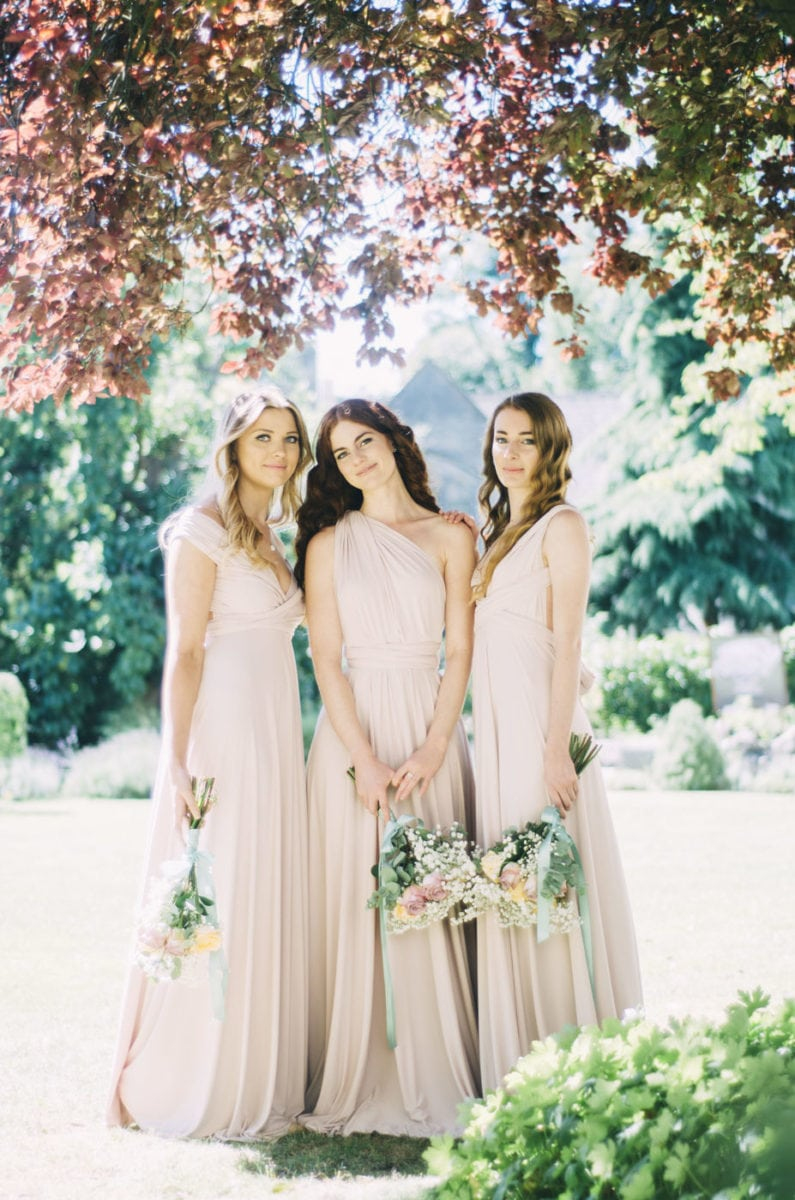 Blush coloured multiway bridesmaids dresses. Wrap styles - off the shoulder dress, one shoulder dress & plunge neck dress