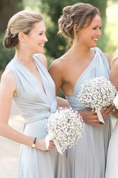 Charlies Brismaids in Dove Grey dresses with gypsophila bouquets