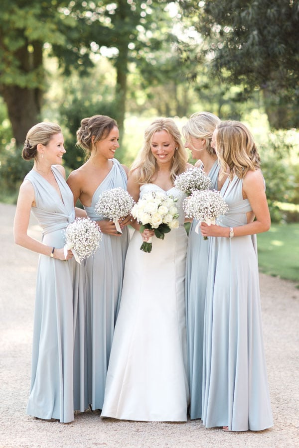 Charlie's beautiful Dove Grey bridesmaid dresses wrapped and worn to reflect each maids individual style.