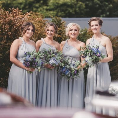 Dove Grey bridemsids dresses. Willow mutliway dress all tied in a one shoulder dress style.