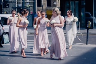 Kimberley's bridesmaids in Blush pink Willow multiway dresses - full length and midi length.