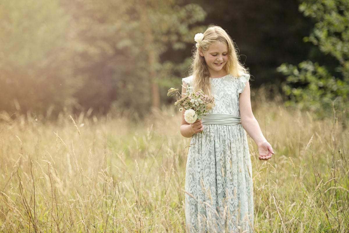 Lace flower girl dress in Sage green. Short and long lengths available and 36 colour combinations.