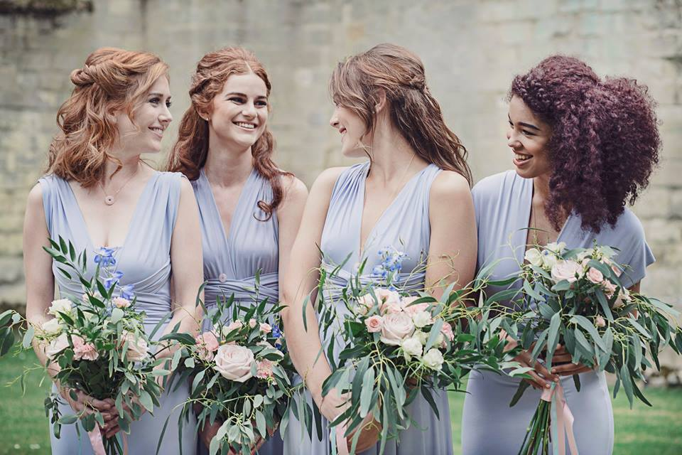 Pale blue Periwinkle multiway dresses for bridesmaids. Willow floaty gown dress and fitted Pearl dresses.