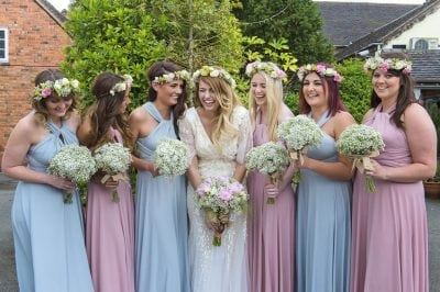 Sally's bridesmaids in Dove Grey and Dusky Pink Willow multiways dresses.